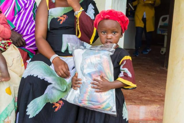 Child with mosquito net